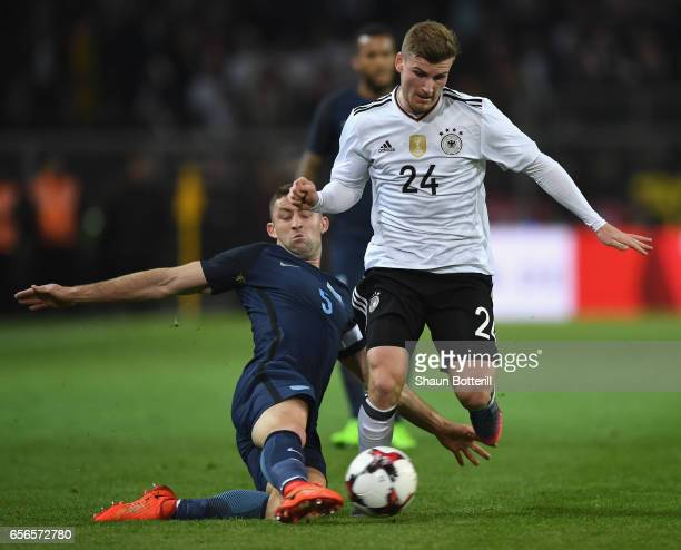 Gary Cahill of England tackles Timo Werner of Germany during the international friendly match between Germany and England at Signal Iduna Park on...