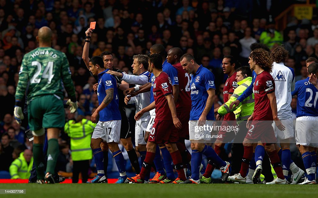 Gary Cahill of Evertonis shown the red card at the end of the match by referee Mr Andre Marriner during the Barclays Premier League match between...