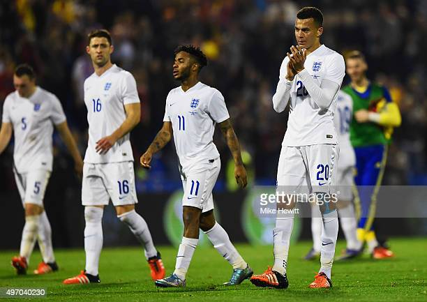 Gary Cahill Raheem Sterling and Dele Alli of England look dejected in defeat after the international friendly match between Spain and England at Jose...