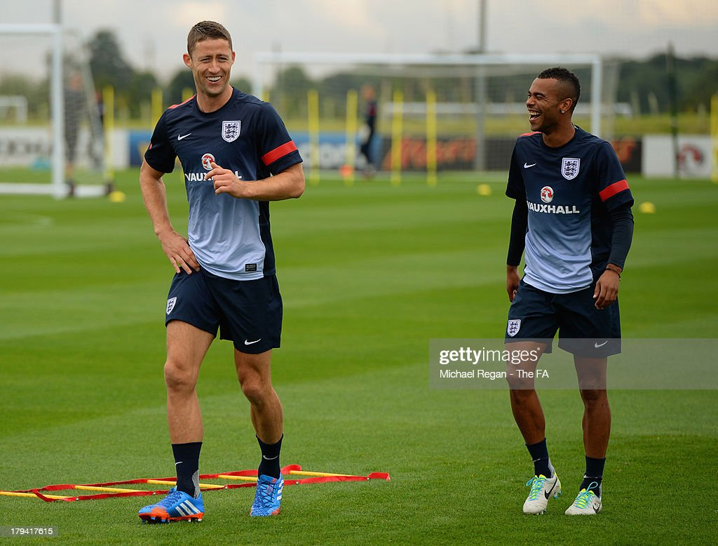 Gary Cahill shares a joke with Ashley Cole during the England training session and press conference at St Georges Park on September 3, 2013 in Burton-upon-Trent, England.