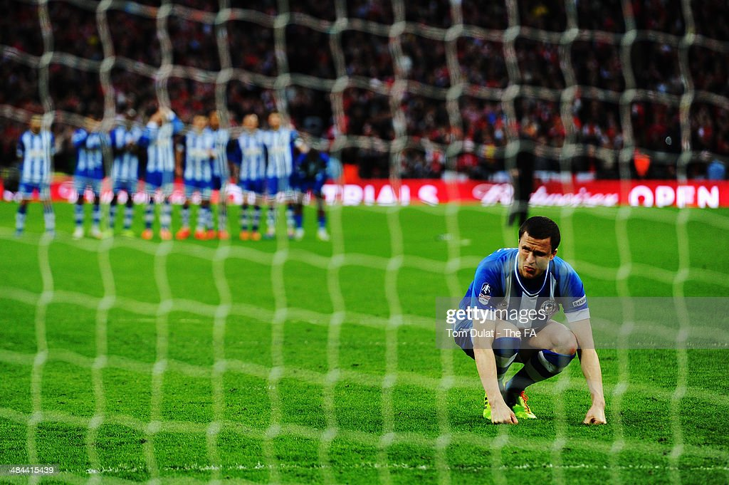 Gary Caldwell of Wigan Athletic reacts after missing a penalty in the penalty shoot-out during the FA Cup Semi-Final match between Wigan Athletic and Arsenal at Wembley Stadium on April 12, 2014 in London, England.