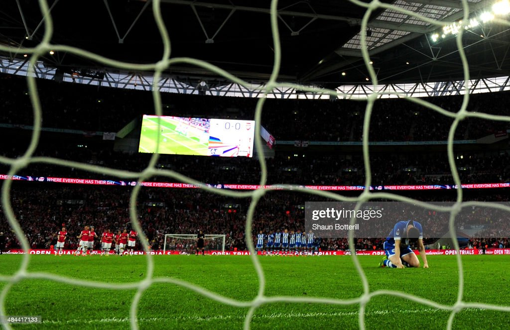 Gary Caldwell of Wigan Athletic reacts after missing a penalty in the shoot out during the FA Cup Semi-Final match between Wigan Athletic and Arsenal at Wembley Stadium on April 12, 2014 in London, England.