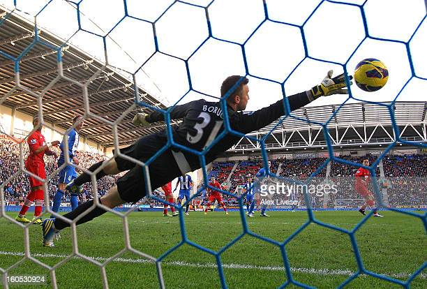 Gary Caldwell of Wigan Athletic scores the opening goal past Artur Boruc of Southampton during the Barclays Premier League match between Wigan...
