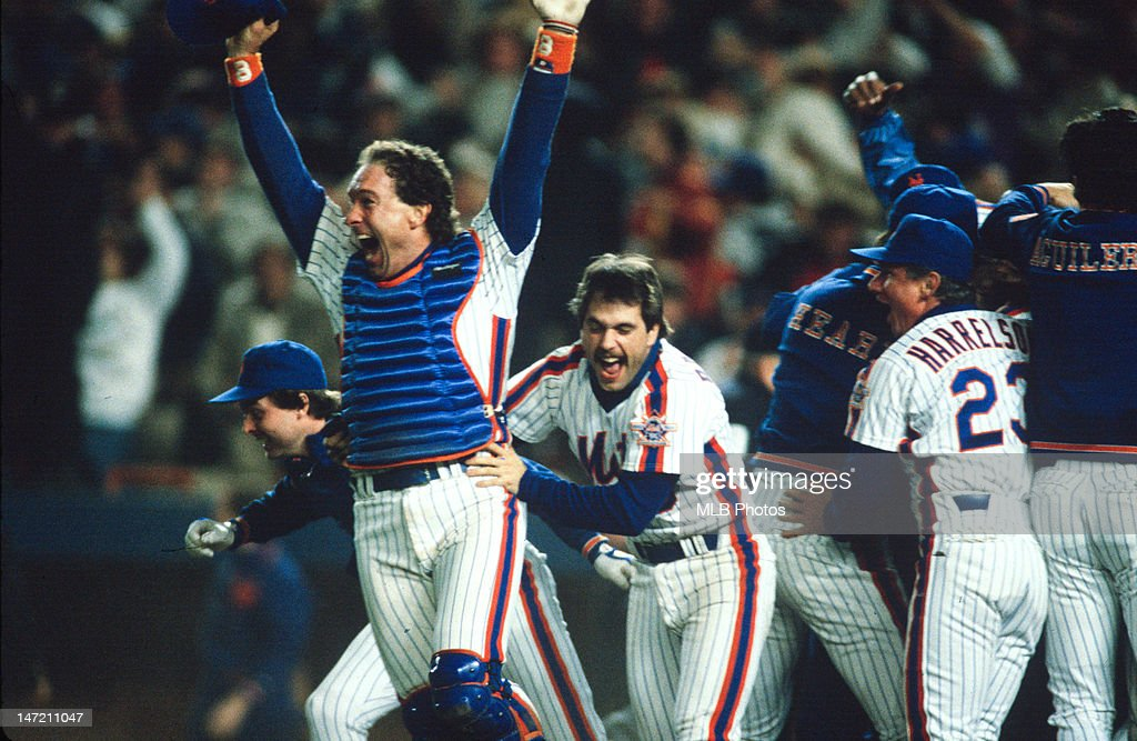Gary Carter and Wally Backman of New York Mets celebrate after winning the 1986 Major League Baseball World Series between the New York Mets and the...