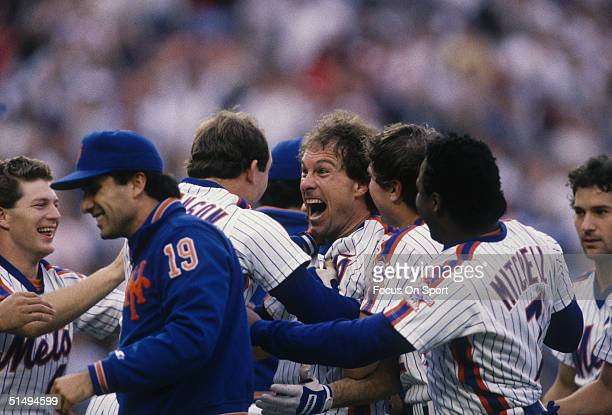 Gary Carter embraces teammate Howard Johnson of the New York Mets after defeating the Houston Astros during the National League Championship Series...
