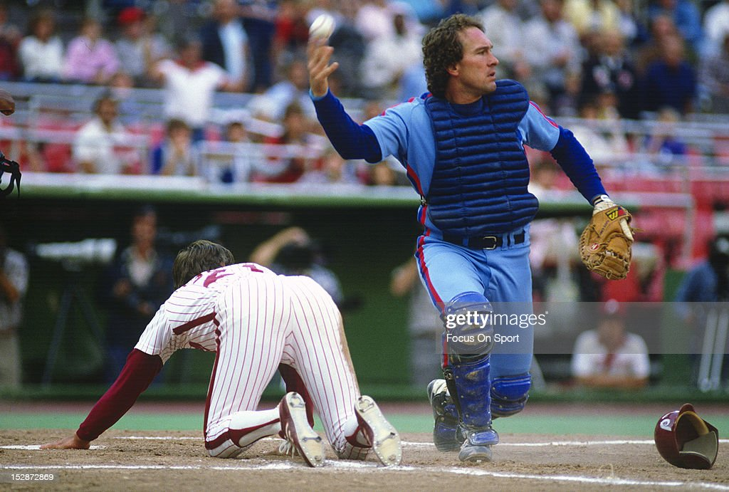 Gary Carter #8 of the Montreal Expos looks on after making a play on the runner at home plate against the Philadelphia Phillies during an Major League Baseball game circa 1982 at Veterans Stadium in Philadelphia, Pennsylvania. Carter played for the Expos from 1974-84 and 1992.