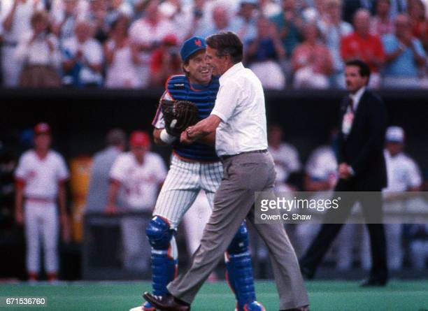 CINCINNATI OH Gary Carter of the New York Mets congratulates Vice President George H W Bush after First pitch at the 1988 MLB All Star Game at...