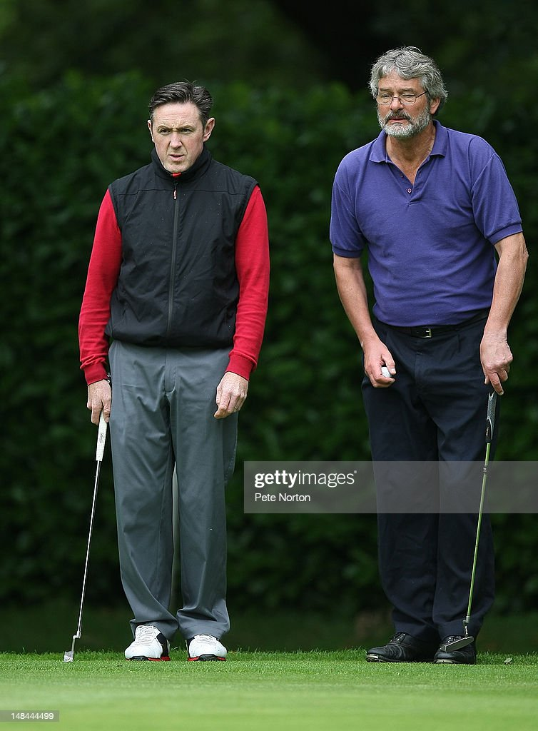 Gary Casey (l) and Martin Gee of Thorpe Wood Golf Club line up a shot on the 1st green during the Virgin Atlantic PGA National Pro-Am Championship - Regional Final at King's Lynn Golf Club on July 16, 2012 in King's Lynn, England.