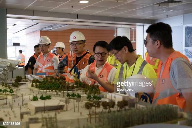Gary Chan Hakkan member of the Legislative Council center views a model of the GuangzhouShenzhenHong Kong Express Rail Link at the West Kowloon...