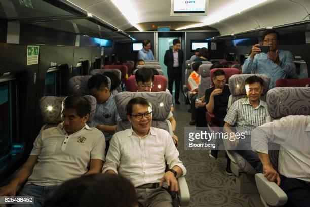 Gary Chan Hakkan member of the Legislative Council front row center sits onboard a carriage of the GuangzhouShenzhenHong Kong Express Rail Link in...