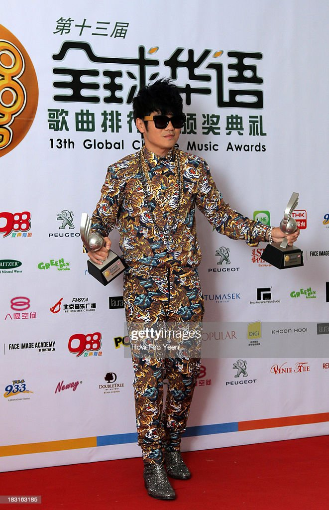 Gary Chow of Malaysia poses with his Awards at back stage during the 13th Global Chinese Music Awards at Putra Stadium on October 5, 2013 in Kuala Lumpur, Malaysia.