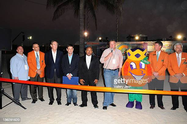 Gary Cioffi Eric Poms Jerry Libbin Michael Gongora Daymond John shawn Garrity Luis E Boue and Jeffery T Roberts attend the Ribbon Cutting Ceremony at...