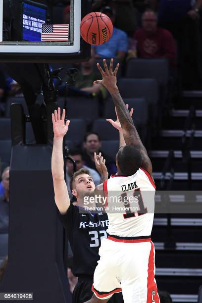 Gary Clark of the Cincinnati Bearcats attempts a shot defended by Dean Wade of the Kansas State Wildcats during the first round of the 2017 NCAA...