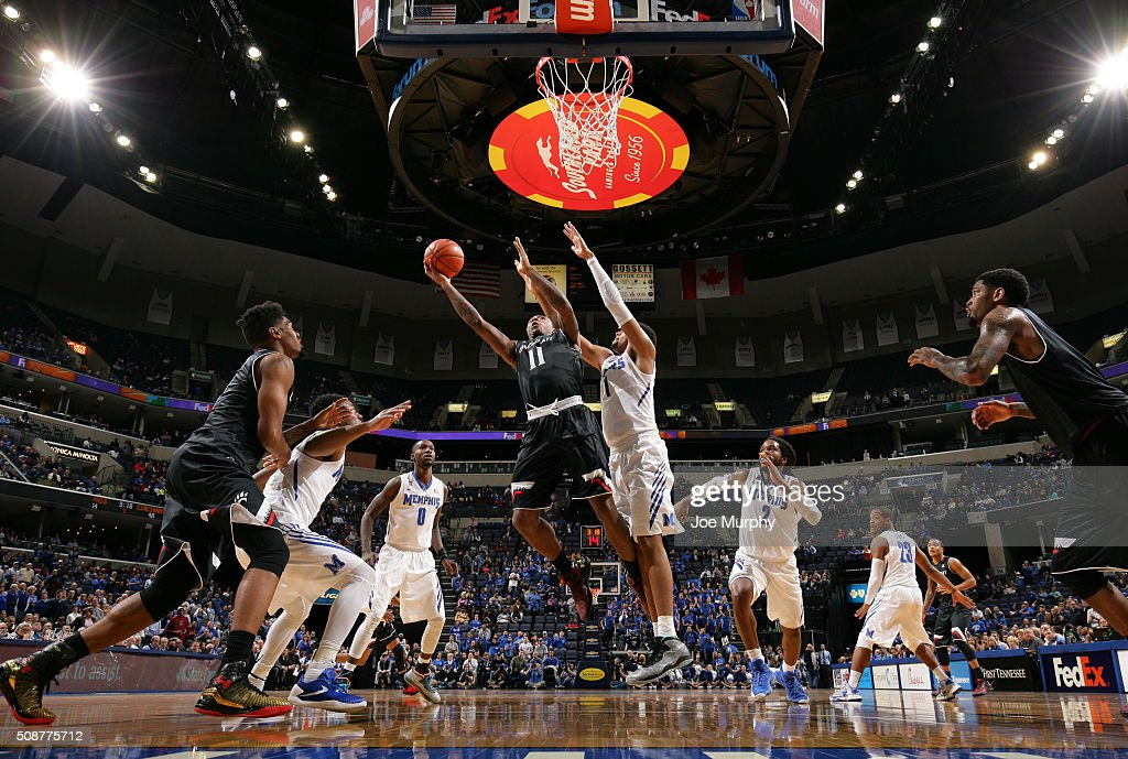 Gary Clark #11 of the Cincinnati Bearcats shoots a layup against Dedric Lawson #1 of the Memphis Tigers on February 6, 2016 at FedExForum in Memphis. Memphis defeated Cincinnati 63-59.