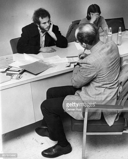 Gary Clough left and Norman Charles hand over face answer officer Patrolman Mike O'Neill back to camera interrogates them at police substationPolice...