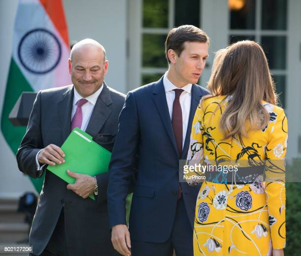 Gary Cohn Chief economic advisor to President Donald Trump and Director of the National Economic Council walks past Jared Kushner Senior Advisor to...