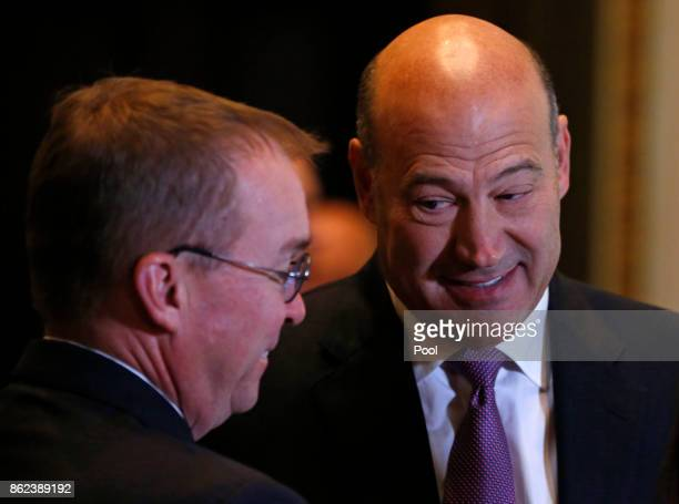Gary Cohn chief economic advisor to the president chats with Office of Management and Budget Director Mick Mulvaney in the Indian Treaty Room of the...