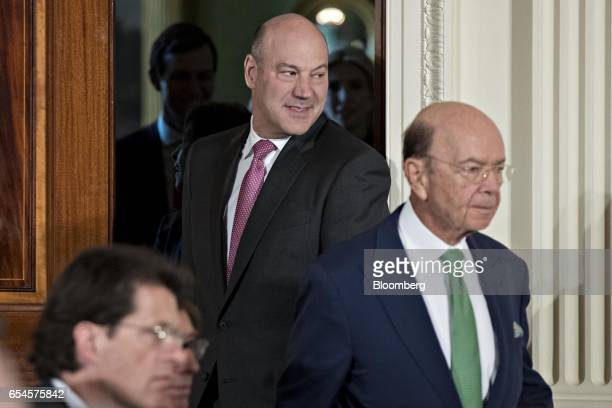 Gary Cohn director of the US National Economic Council center and Gary Cohn US commerce secretary arrive to a news conference with US President...