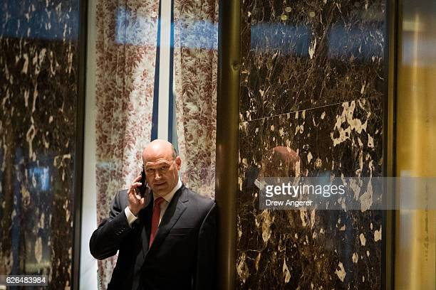 Gary Cohn president and chief operating officer at Goldman Sachs talks on his phone as he arrives at Trump Tower November 29 2016 in New York City...