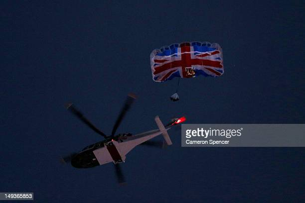 Gary Connery and Mark Sutton parachute into the stadium as part of short James Bond film featuring Daniel Craig and The Queen during the Opening...