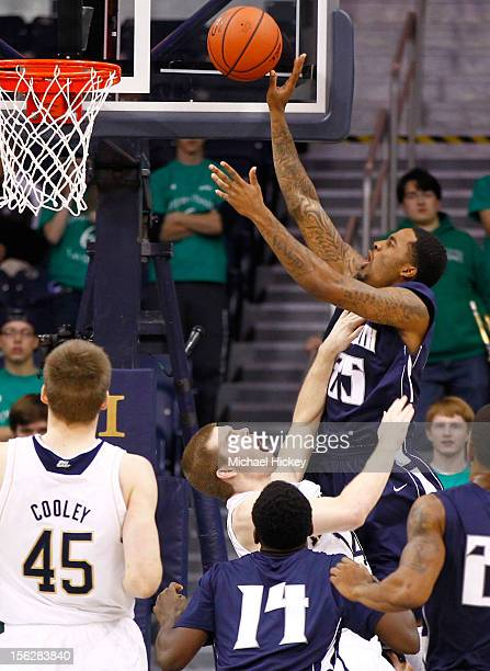 Gary Cox of the Monmouth Hawks goes up to shoot over Scott Martin of the Notre Dame Fighting Irish at Purcel Pavilion on November 12 2012 in South...