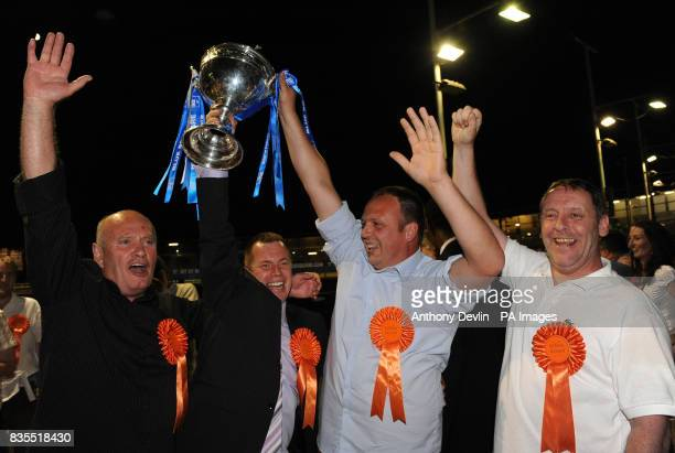 Gary Crouch trainer Mark Wallis assistant trainer Patrick Jamssens and Gary Budger celebrate as Kinda Ready wins the Greyhound Derby Final at...