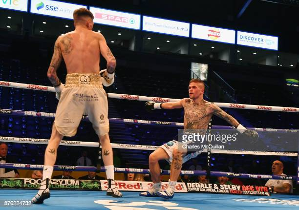Gary Cully knocks Kane Baker to the floor during their Lightweight bout on the Frampton Reborn boxing bill at SSE Arena Belfast on November 11 2017...