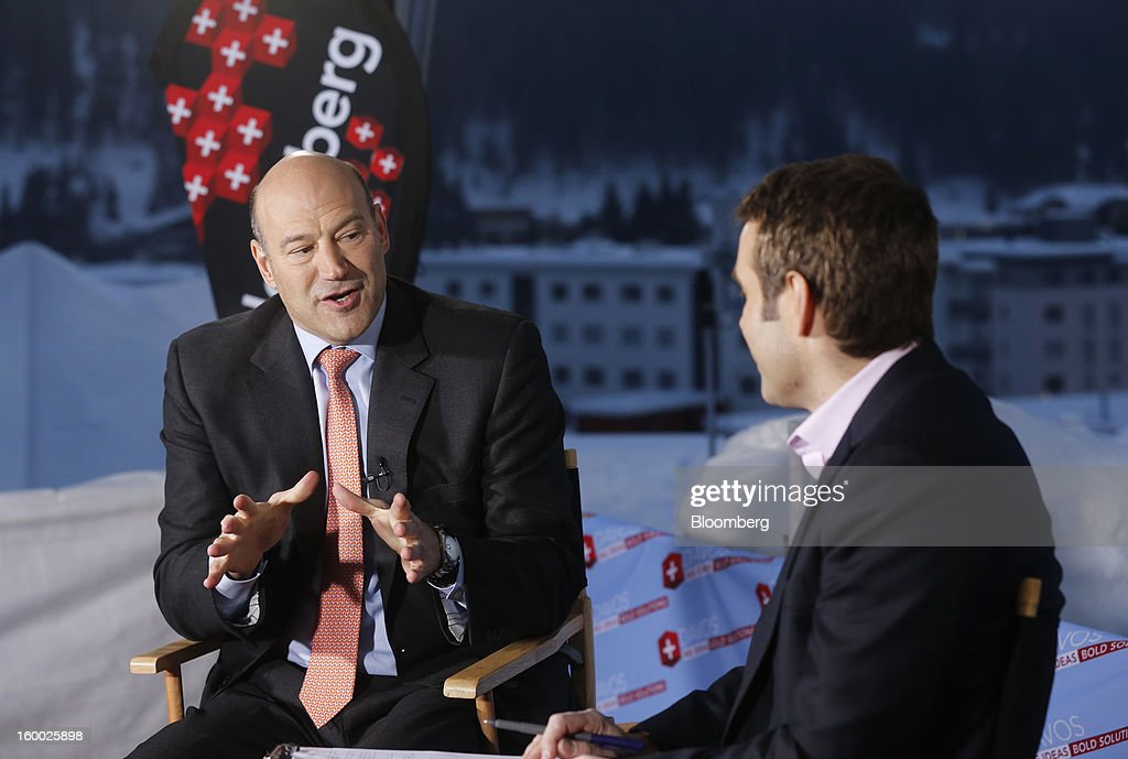 Gary D. Cohn, president and chief operating officer of Goldman Sachs Group Inc., left, gestures as he speaks during a Bloomberg Television interview on day two of the World Economic Forum (WEF) in Davos, Switzerland, on Thursday, Jan. 24, 2013. World leaders, influential executives, bankers and policy makers attend the 43rd annual meeting of the World Economic Forum in Davos, the five day event runs from Jan. 23-27. Photographer: Simon Dawson/Bloomberg via Getty Images