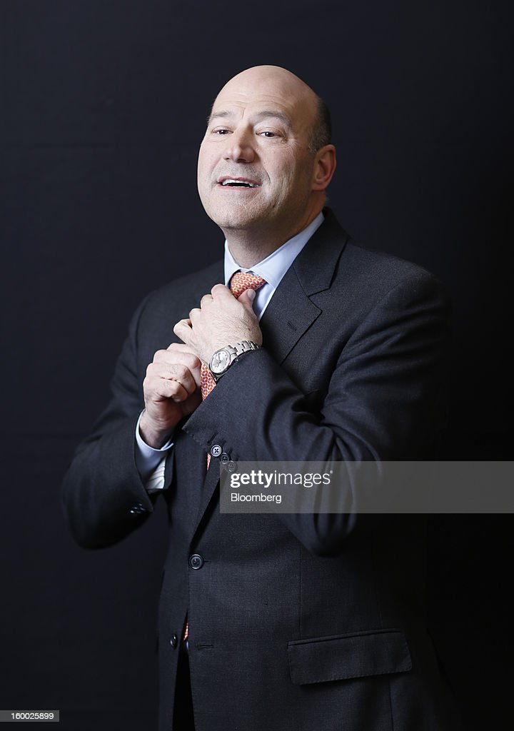 Gary D. Cohn, president and chief operating officer of Goldman Sachs Group Inc., adjusts his tie prior to posing for a photograph following a Bloomberg Television interview on day two of the World Economic Forum (WEF) in Davos, Switzerland, on Thursday, Jan. 24, 2013. World leaders, influential executives, bankers and policy makers attend the 43rd annual meeting of the World Economic Forum in Davos, the five day event runs from Jan. 23-27. Photographer: Simon Dawson/Bloomberg via Getty Images