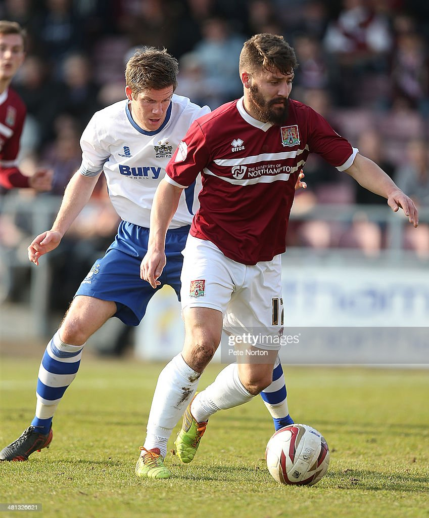 Gary Deegan of Northampton Town controls the ball watched by Andrew Procter of Bury during the Sky Bet League Two match between Northampton Town and...
