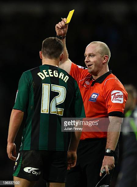 Gary Deegan receives a yellow card from referee Simon Hooper during the npower Championship match between West Ham United and Coventry City at Boleyn...