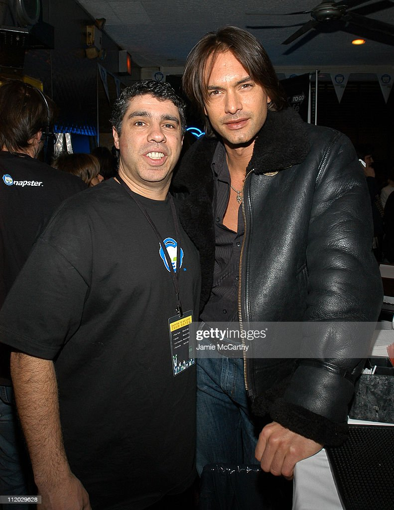 Gary Dell'Abate and Marcus Schenkenberg during Napster Launches 'Napster To Go' Cafe Tour with Free Music and MP3 Players at Coffee Shop in New York...