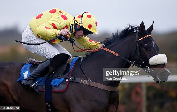 Gary Derwin riding Clic Work clear the last to win The Reliable British Scaffolders Handicap Hurdle Race at Taunton Racecourse on November 24 2016 in...