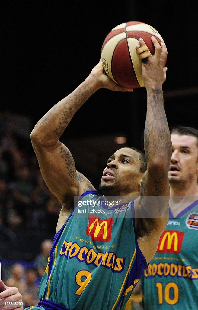 Gary Ervin of Crocodiles makes a jump shot during the round 23 NBL match between the Townsville Crocodiles and the Melbourne Tigers at Townsville Entertainment Centre on March 17, 2013 in Townsville, Australia.