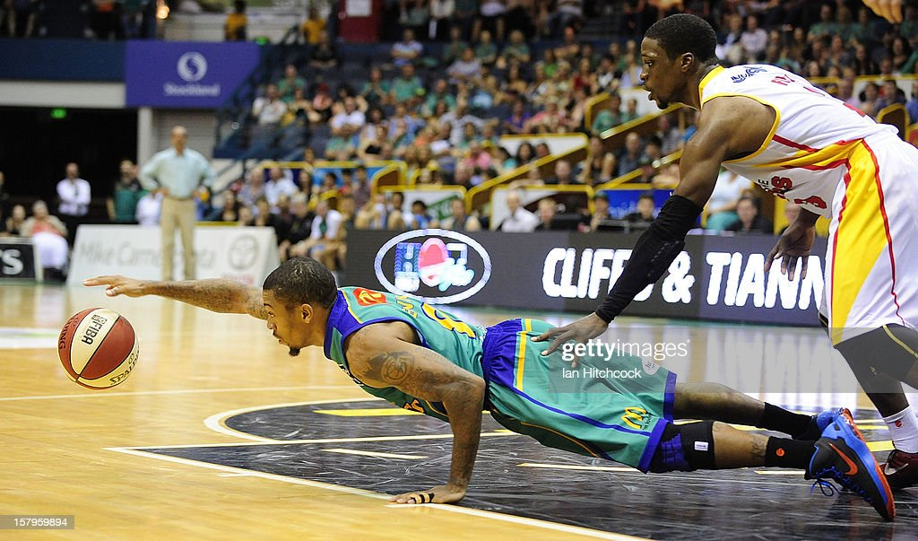 Gary Ervin of the Crocodiles dives for the ball past Jonny Flynn of the Tigers during the round ten NBL match between the Townsville Crocodiles and the Melbourne Tigers at Townsville Entertainment Centre on December 8, 2012 in Townsville, Australia.