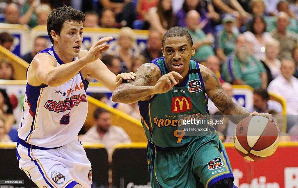 Gary Ervin of the Crocodiles drives to the basket past Tom Daly of the 36ers during the round 12 NBL match between the Townsville Crocodiles and the Adelaide 36ers at Townsville Entertainment Centre on December 31, 2012 in Townsville, Australia.