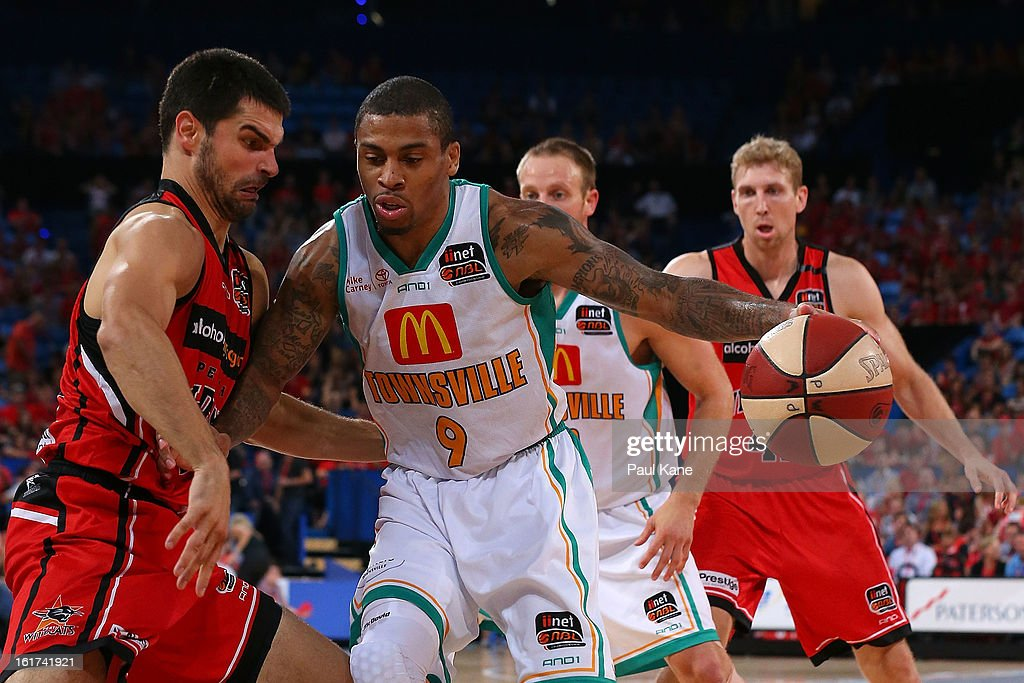 Gary Ervin of the Crocodiles looks to dribble past Kevin Lisch of the Wildcats during the round 19 NBL match between the Perth Wildcats and the Townsville Crocodiles at Perth Arena on February 15, 2013 in Perth, Australia.