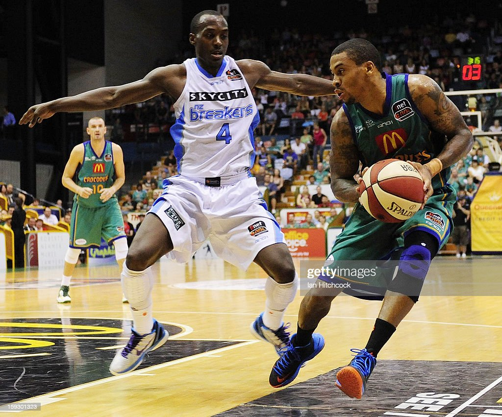 Gary Ervin of the Crocodiles looks to get past Cedric Jackson of the Breakers during the round 14 NBL match between the Townsville Crocodiles and the New Zealand Breakers at Townsville Entertainment Centre on January 11, 2013 in Townsville, Australia.