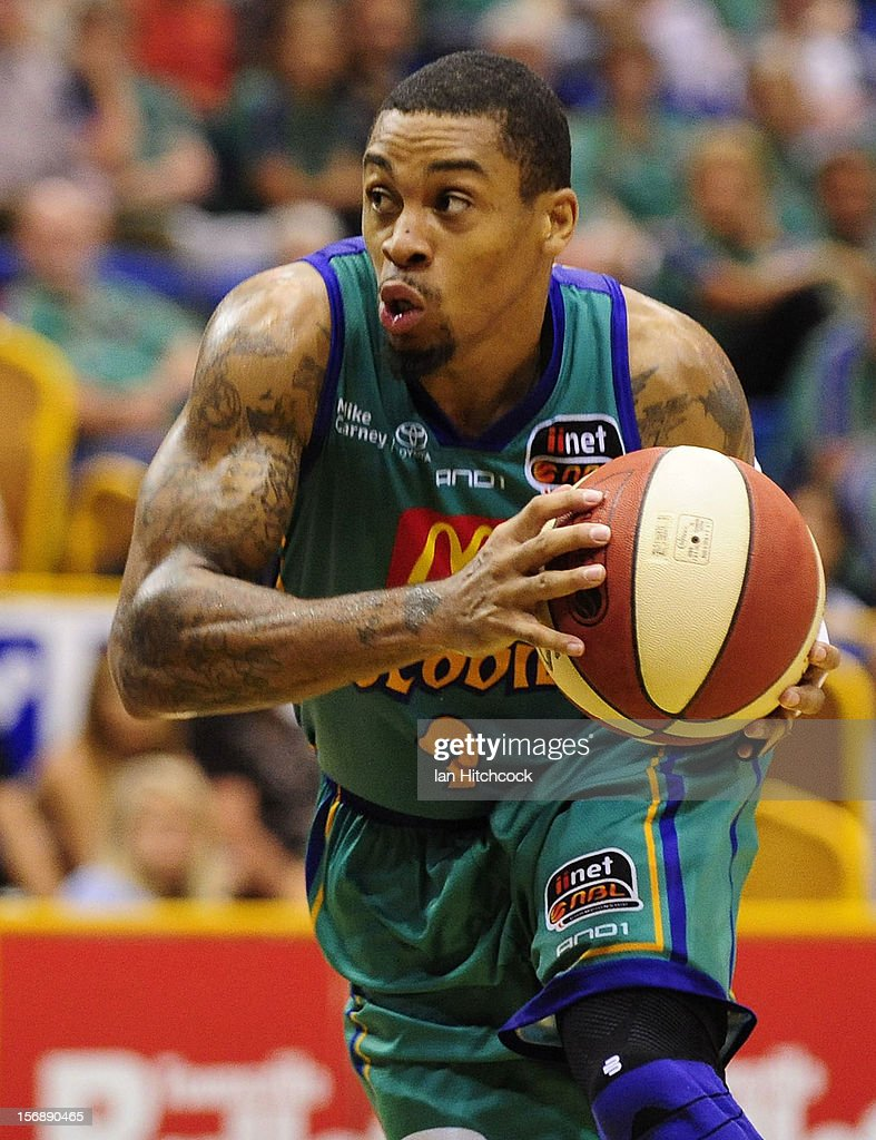 Gary Ervin of the Crocodiles looks to pass the ball during the round eight NBL match between the Townsville Crocodiles and the Perth Wildcats at Townsville Entertainment Centre on November 24, 2012 in Townsville, Australia.