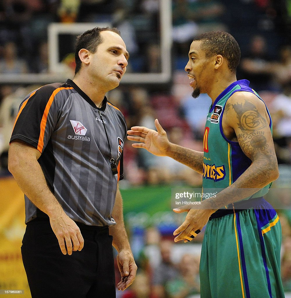 Gary Ervin of the Crocodiles talks with a referee during the round ten NBL match between the Townsville Crocodiles and the Melbourne Tigers at Townsville Entertainment Centre on December 8, 2012 in Townsville, Australia.