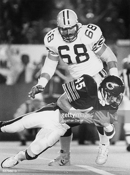Gary Fencik of the Chicago Bears intercepts a pass as Greg Koch of the Green Bay Packers looks on during the game at Soldier Field on October 21 1985...