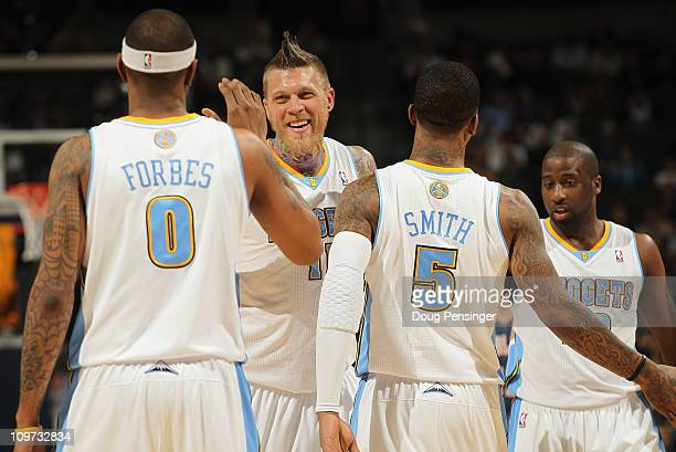 Gary Forbes Chris Andersen JR Smith and Raymond Felton of the Denver Nuggets celebrate against the Charlotte Bobcats at the Pepsi Center on March 2...
