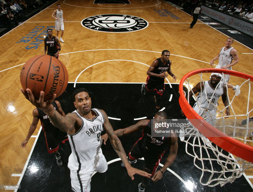 <a gi-track='captionPersonalityLinkClicked' href=/galleries/search?phrase=Gary+Forbes&family=editorial&specificpeople=2558000 ng-click='$event.stopPropagation()'>Gary Forbes</a> #9 of the Brooklyn Nets goes up to shoot over <a gi-track='captionPersonalityLinkClicked' href=/galleries/search?phrase=Jarvis+Varnado&family=editorial&specificpeople=4186391 ng-click='$event.stopPropagation()'>Jarvis Varnado</a> #24 of the Miami Heat during a preseason game at the Barclays Center on October 17, 2013 in the Brooklyn borough of New York City.