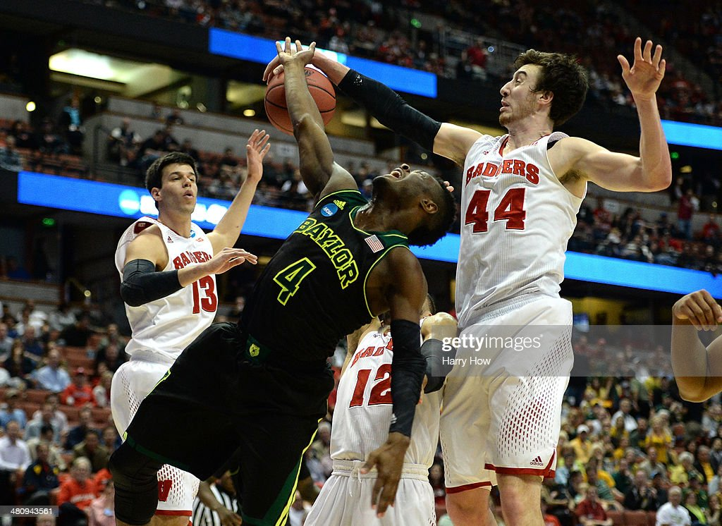 Gary Franklin #4 of the Baylor Bears has his shot blocked by <a gi-track='captionPersonalityLinkClicked' href=/galleries/search?phrase=Frank+Kaminsky&family=editorial&specificpeople=8685398 ng-click='$event.stopPropagation()'>Frank Kaminsky</a> #44 of the Wisconsin Badgers in the first half during the regional semifinal of the 2014 NCAA Men's Basketball Tournament at the Honda Center on March 27, 2014 in Anaheim, California.