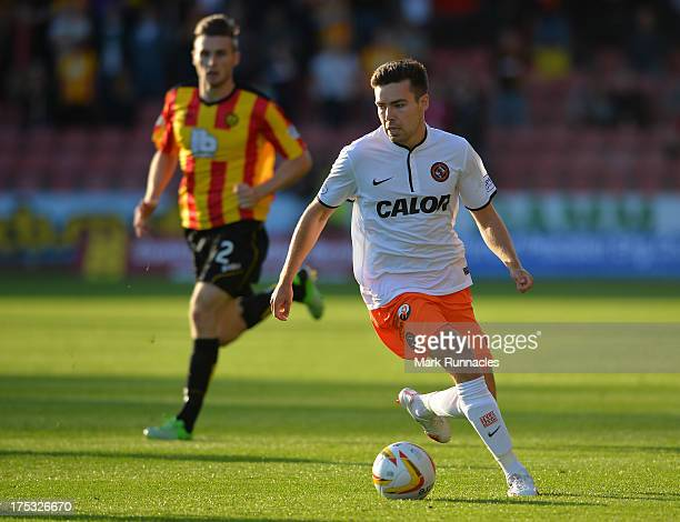 Gary Fraser of Partick Thistle and Ryan Dowe of Dundee United in action during the Scottish Premiership League match between Partick Thistle and...