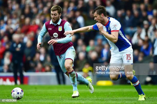 Gary Gardner of Aston Villa competes with Elliott Ward of Blackburn Rovers during the Sky Bet Championship match between Blackburn Rovers and Aston...