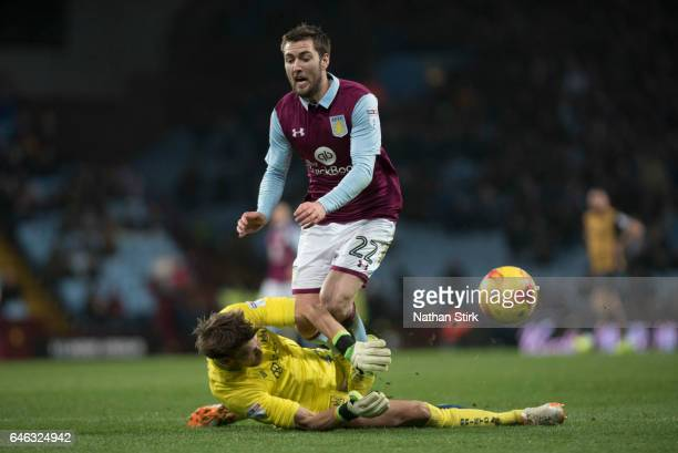 Gary Gardner of Aston Villa is awarded a penalty after Fabian Giefer of Bristol City miss times his tackle during the Sky Bet Championship match...
