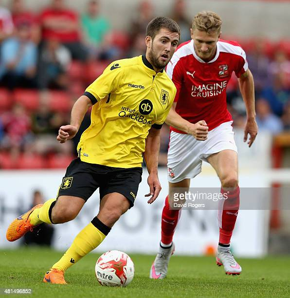 Gary Gardner of Aston Villa moves away with the ball during the pre season friendly match between Swindon Town and Aston Villa at the County Ground...