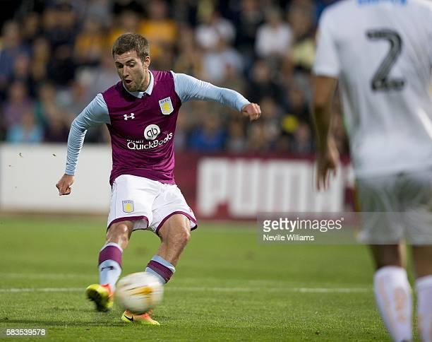 Gary Gardner of Aston Villa scores for Aston Villa during a Pre Season Friendly match between Cambridge United and Aston Villa at the Abbey Stadium...
