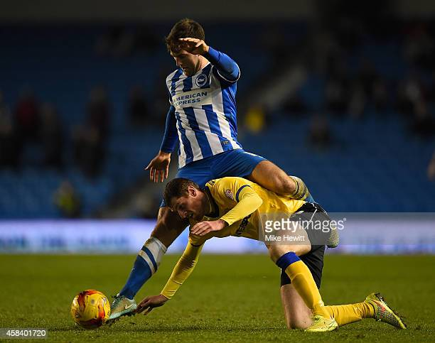 Gary Gardner of Brighton tangles with Chris McCann of Wigan during the Sky Bet Championship match between Brighton Hove Albion and Wigan Athletic at...